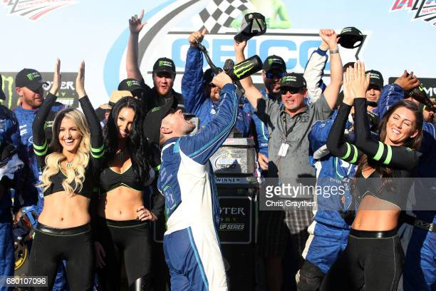 Ricky Stenhouse Jr driver of the Fifth Third Bank Ford celebrates with champagne in Victory Lane after winning the Monster Energy NASCAR Cup Series...