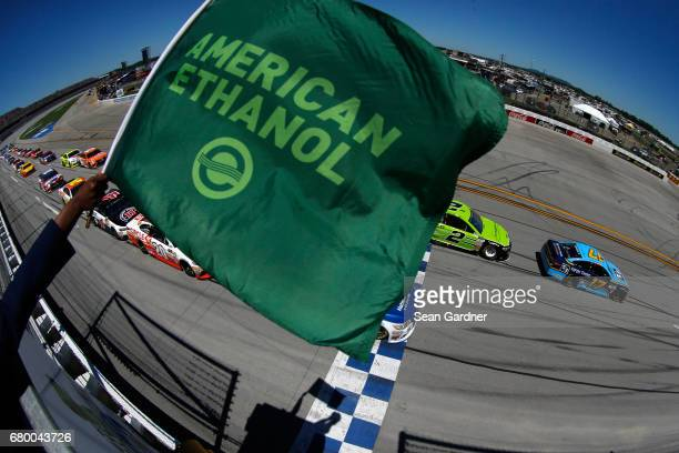 Ricky Stenhouse Jr driver of the Fifth Third Bank Ford leads the field past the green flag to start the Monster Energy NASCAR Cup Series GEICO 500 at...