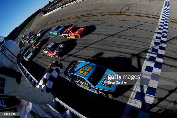 Ricky Stenhouse Jr driver of the Fifth Third Bank Ford takes the checkered flag to win the Monster Energy NASCAR Cup Series GEICO 500 at Talladega...