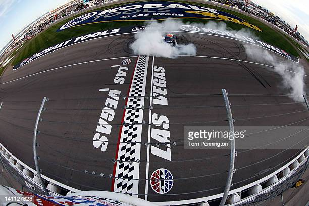 Ricky Stenhouse Jr driver of the Ford EcoBoost Ford celebrates with a burnout after winning the NASCAR Nationwide Series Sam's Town 300 at Las Vegas...