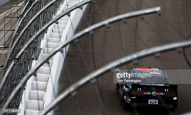 Ricky Stenhouse Jr driver of the Ford EcoBoost Ford celebrates with the checkered flag after winning the NASCAR Nationwide Series Sam's Town 300 at...