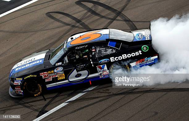 Ricky Stenhouse Jr driver of the Ford EcoBoost Ford does a burnout after winning the NASCAR Nationwide Series Sam's Town 300 at Las Vegas Motor...