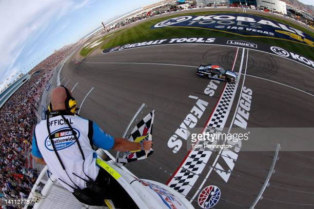 Ricky Stenhouse Jr driver of the Ford EcoBoost Ford takes the checkered flag as he crosses the finish line to win the NASCAR Nationwide Series Sam's...