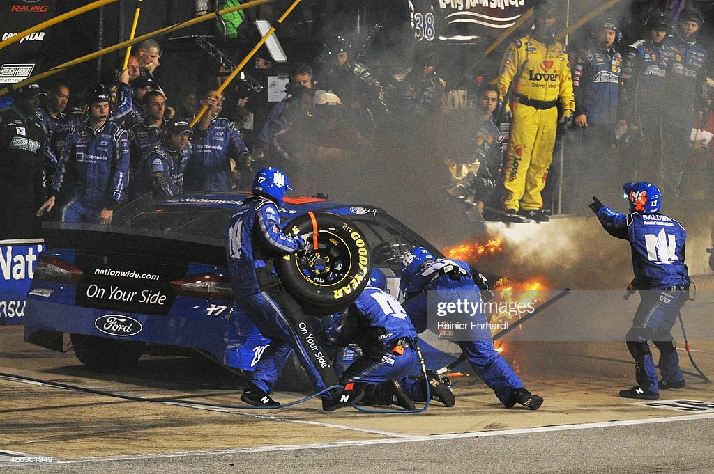 Ricky Stenhouse Jr., driver of the #17 FrdNationwide Ford, pits while on fire during the NASCAR Sprint Cup Series Toyota Owners 400 at Richmond International Raceway on April 26, 2014 in Richmond, Virginia.
