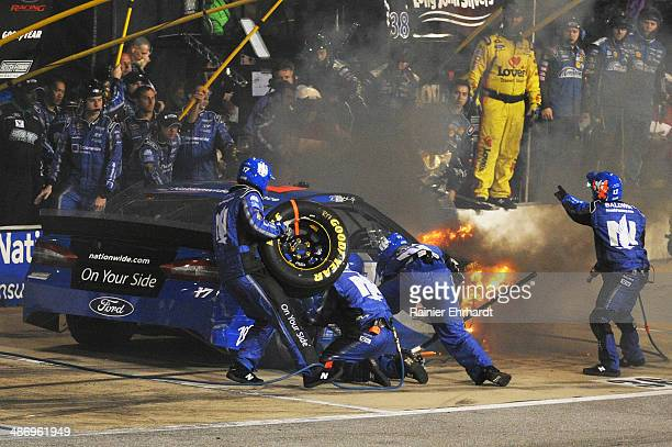 Ricky Stenhouse Jr driver of the FrdNationwide Ford pits while on fire during the NASCAR Sprint Cup Series Toyota Owners 400 at Richmond...