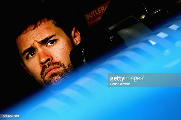 Ricky Stenhouse Jr driver of the FrdNationwide Ford sits in his car during practice for the NASCAR Sprint Cup Series Toyota Owners 400 at Richmond...