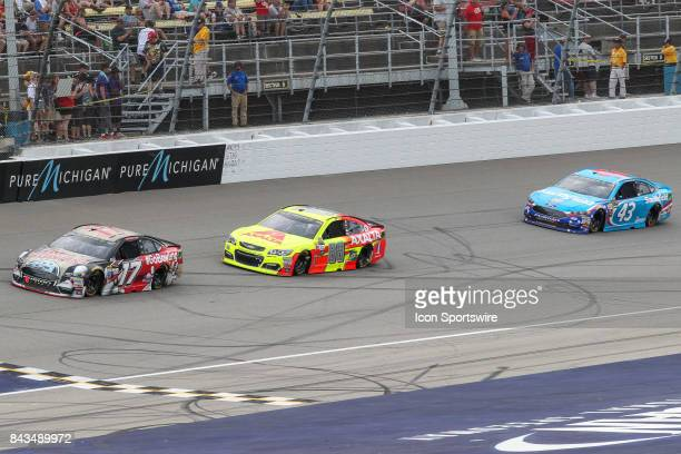 Ricky Stenhouse Jr driver of the Go Bowling Ford Dale Earnhardt Jr driver of the Axalta Chevrolet and Aric Almirola driver of the Smithfield Ford...