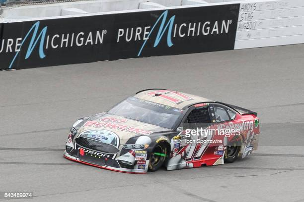 Ricky Stenhouse Jr driver of the Go Bowling Ford races during the Monster Energy NASCAR Cup Series Pure Michigan 400 race on August 13 2017 at...