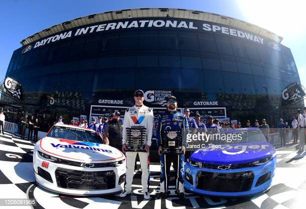 Ricky Stenhouse Jr driver of the Kroger Chevrolet and Alex Bowman driver of the Valvoline Chevrolet pose with the front row awards following...