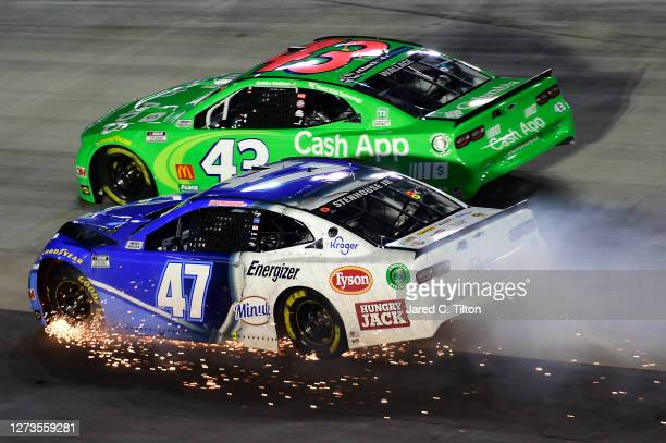 Ricky Stenhouse Jr., driver of the Kroger Chevrolet, drives with sparks after an on-track incident as Bubba Wallace, driver of the Cash App...