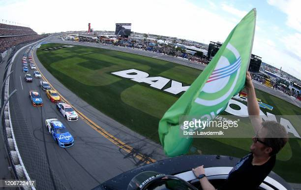 Ricky Stenhouse Jr., driver of the Kroger Chevrolet, leads the field to the green flag, waved by former NASCAR driver, Dale Earnhardt, Jr. To start...