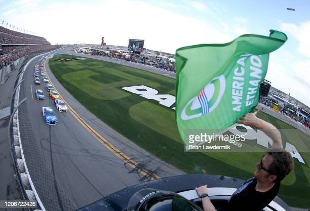 Ricky Stenhouse Jr driver of the Kroger Chevrolet leads the field to the green flag waved by former NASCAR driver Dale Earnhardt Jr to start the...