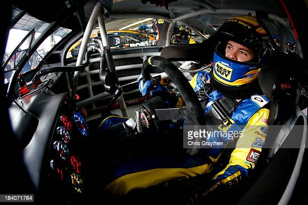 Ricky Stenhouse Jr driver of the My Best Buy Ford sits in his car in the garage area during practice for the NASCAR Sprint Cup Series Bank of America...
