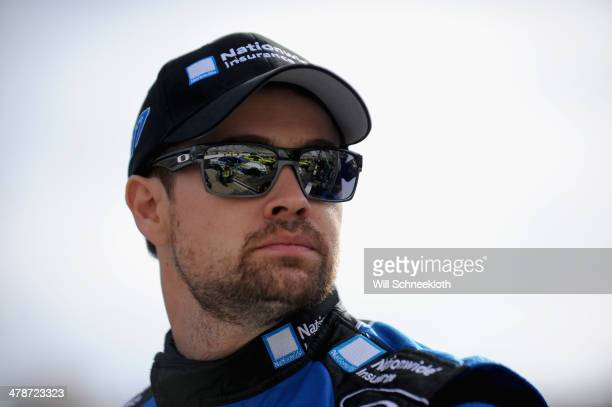 Ricky Stenhouse Jr driver of the Nationwide Insurance Ford stands on the grid during qualifying for the NASCAR Sprint Cup Series Food City 500 at...