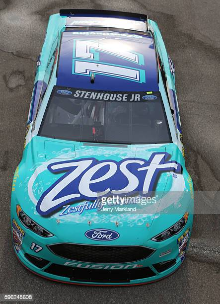 Ricky Stenhouse Jr driver of the Zest Ford drives through the garage area during practice for the NASCAR Sprint Cup Series Pure Michigan 400 at...