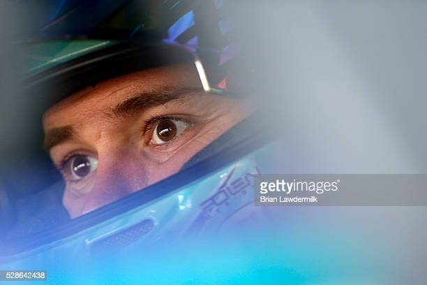 Ricky Stenhouse Jr., driver of the Zest Ford, sits in his car during practice for the NASCAR Sprint Cup Series Go Bowling 400 at Kansas Speedway on...