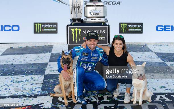 Ricky Stenhouse Jr Roush Fenway Racing Fifth Third Bank Ford Fusion in Victory Lane and his girlfriend Danica Patrick and their dogs after winning...