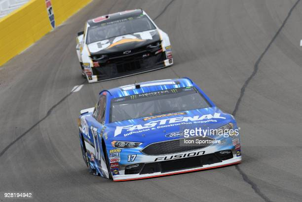 Ricky Stenhouse Jr Roush Fenway Racing Ford Fusion leads Ryan Newman Richard Childress Racing Chevrolet Camaro ZL1 into turn one during practice for...