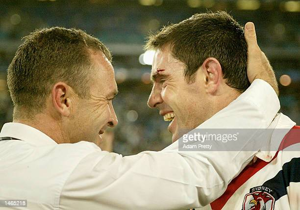 Ricky Stuart coach of the Roosters and Brad Fittler of the Roosters embrace each other after victory in the 2002 NRL Grand Final played between the...