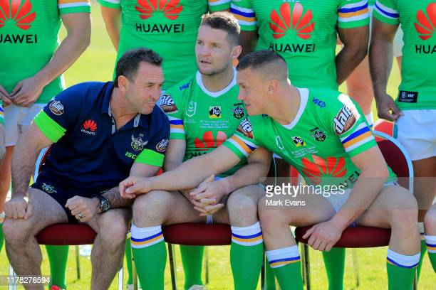 Ricky Stuart talks to Jarrod Croker and Jack Wighton as they wait for a team photo during a Canberra Raiders Training Session Media Opportunity at...