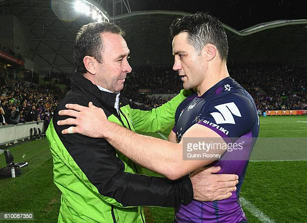 Ricky Stuart the coach of the Raiders hugs Cooper Cronk of the Storm during the NRL Preliminary Final match between the Melbourne Storm and the...