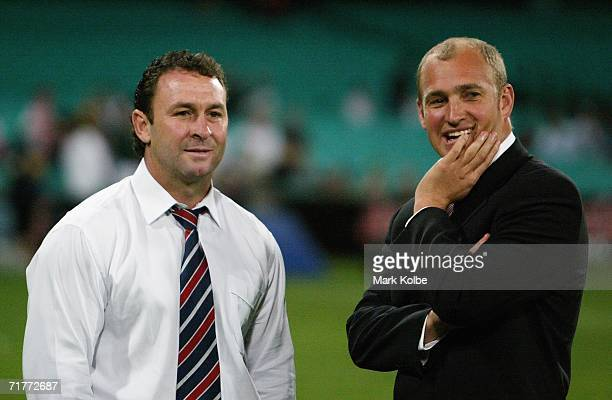 Ricky Stuart the departing Roosters coach speaks with Dragons coach Nathan Brownon the side line after the round 26 NRL match between the Sydney...