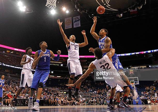 Ricky Tarrant Jr #20 of the Memphis Tigers fouls Shonn Miller of the Connecticut Huskies during the Final of the 2016 AAC Basketball Tournament at...