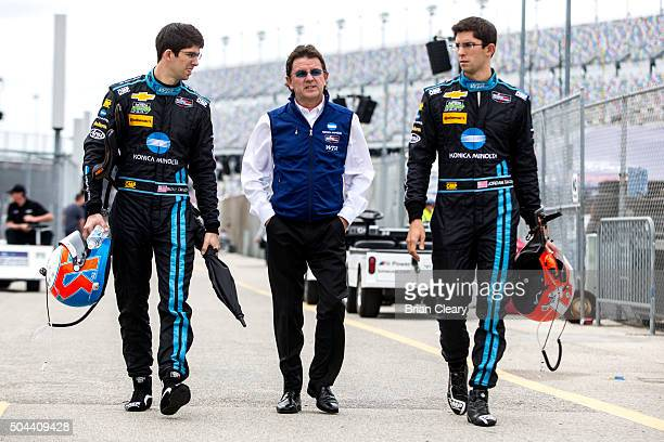 Ricky Taylor and Jordan Taylor walk with their father Wayne Taylor during the Roar Before the 24 IMSA WeatherTech Series testing at Daytona...