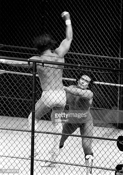 Ricky The Dragon Steamboat chops Randy Macho Man Savage during their WWF steel cage match circa 1987