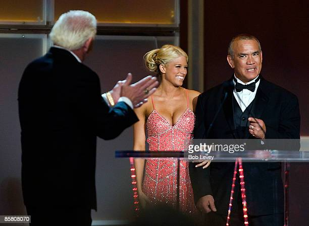 Ricky The Dragon Steamboat is escorted to the podium by WWE Diva Kelly Kelly asa he attends the 25th Anniversary of WrestleMania's WWE Hall of Fame...