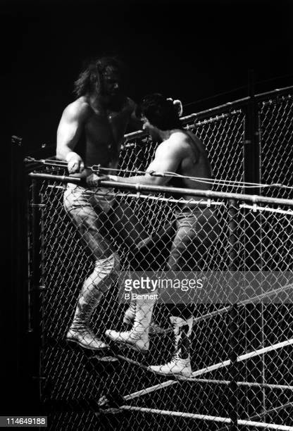 Ricky The Dragon Steamboat wrestles with Randy Macho Man Savage on the top turn buckle during their WWF steel cage match circa 1987