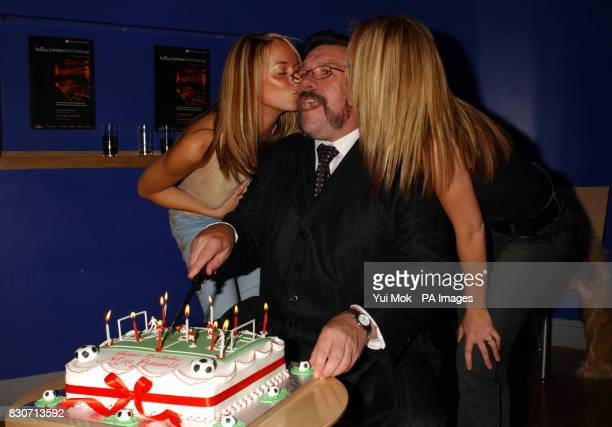 Ricky Tomlinson receives birthday kisses from Liz McClarnon and Natasha Hamilton of Atomic Kitten as he cuts his birthday cake at the world premiere...