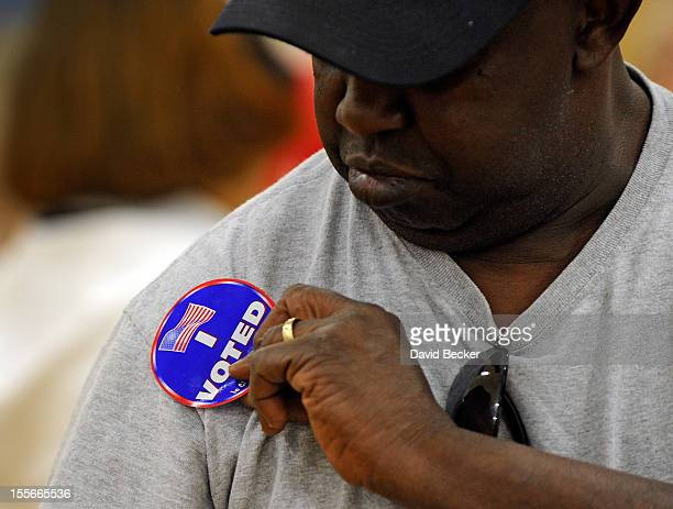 Ricky Tyler puts his I Voted sticker on after casting his ballot at John Fremont Middle School on November 6 2012 in Las Vegas Nevada Voting is...