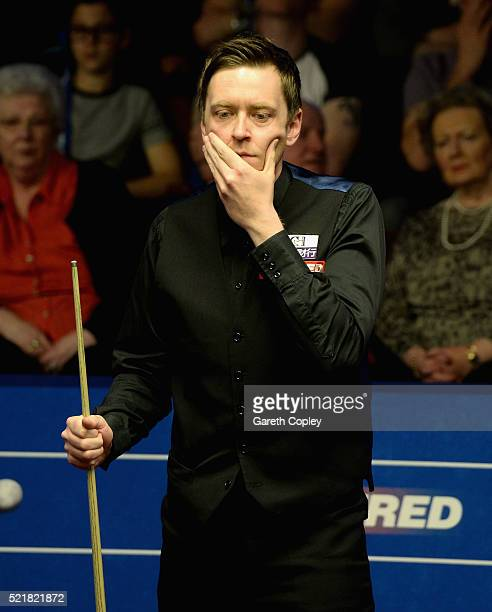 Ricky Walden lines up a shot against Robbie Williams during their first round match of the 2016 Betfred World Snooker Championship at Crucible...