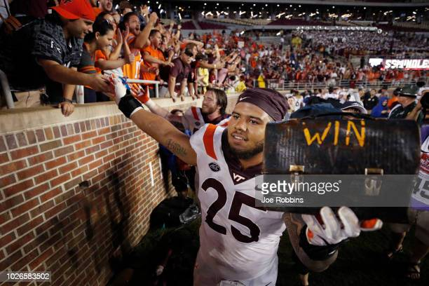 Ricky Walker of the Virginia Tech Hokies wearing the ceremonial jersey No 25 celebrates with fans after the game against the Florida State Seminoles...