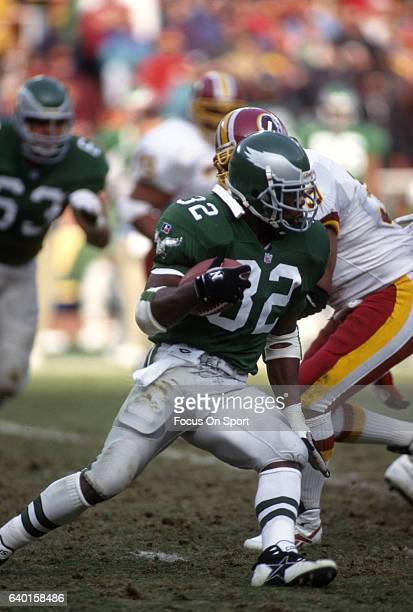 Ricky Watters of the Philadelphia Eagles carries the ball against the Washington Redskins during an NFL football game November 26 1995 at RFK Stadium...