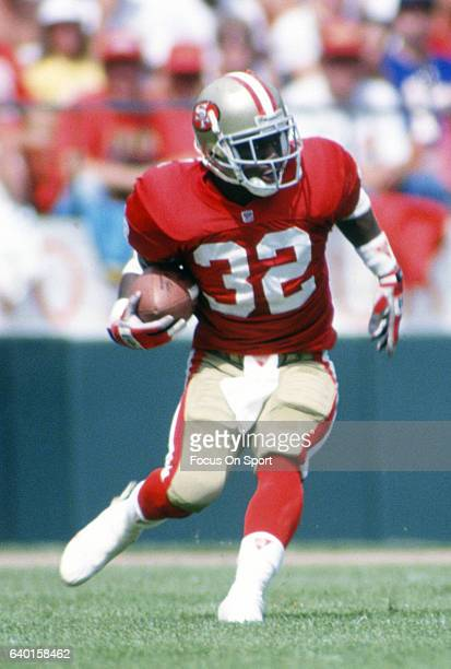 Ricky Watters of the San Francisco 49ers carries the ball against the Buffalo Bills during an NFL football game September 13 1992 at Candlestick Park...