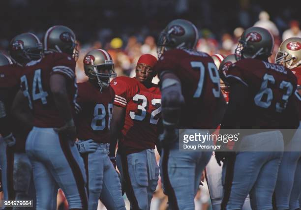 Ricky Watters Running Back for the San Francisco 49ers stands with the offensive line during the National Football Conference East game against the...
