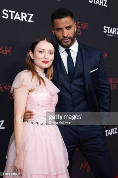 Ricky Whittle and Emily Browning arrives at the premiere of STARZ's 'American Gods' Season 2 at Ace Hotel on March 05 2019 in Los Angeles California