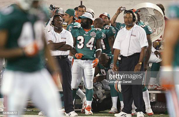 Ricky Williams of the Miami Dolphins stands on the sideline against the Chicago Bears during the NFL Hall of Fame preseason game at Fawcett Stadium...