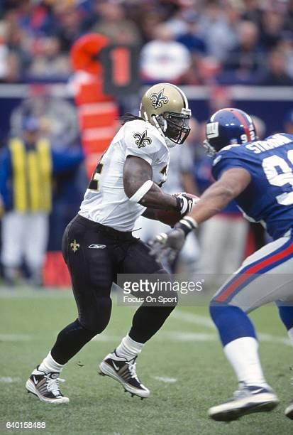 Ricky Williams of the New Orleans Saints carries the ball against the New York Giants during an NFL football game September 30 2001 at Giants Stadium...