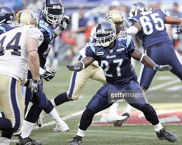 Ricky Williams of the Toronto Argonauts on the sidelines and in action vs the Winnipeg Blue Bombers in a Canadian Football League game at Rogers...