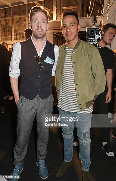 Ricky Wilson and Lewis Hamilton attend the front row at the Oliver Spencer show during London Collections Men SS16 at The Old Sorting Office on June...
