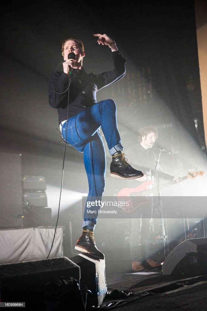 Ricky Wilson and Simon Rix of Kaiser Chiefs perform on stage at Hammersmith Apollo on March 1, 2013 in London, England.
