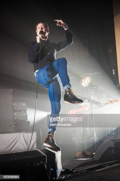 Ricky Wilson and Simon Rix of Kaiser Chiefs perform on stage at Hammersmith Apollo on March 1 2013 in London England