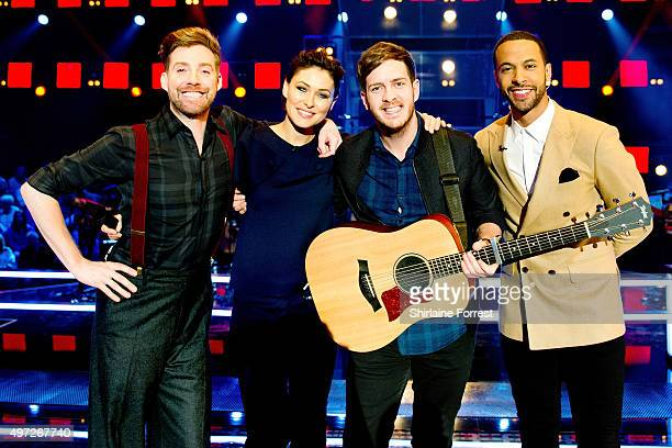 Ricky Wilson Emma Willis Stevie McCrorie and Marvin Humes pose after performing on The Voice on November 15 2015 in Manchester United Kingdom