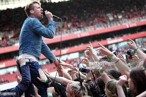 Ricky Wilson of Kaiser Chiefs performs on stage in concert at Emirates Stadium on June 1 2013 in London England