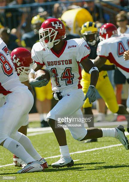 Ricky Wilson of the Houston Cougars carries the ball against the Michigan Wolverines on September 6 2003 in Ann Arbor Michigan Michigan defeated...