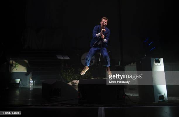 Ricky Wilson of the Kaiser Chiefs jumping while performing on stage at O2 Guildhall on February 16 2019 in Southampton England