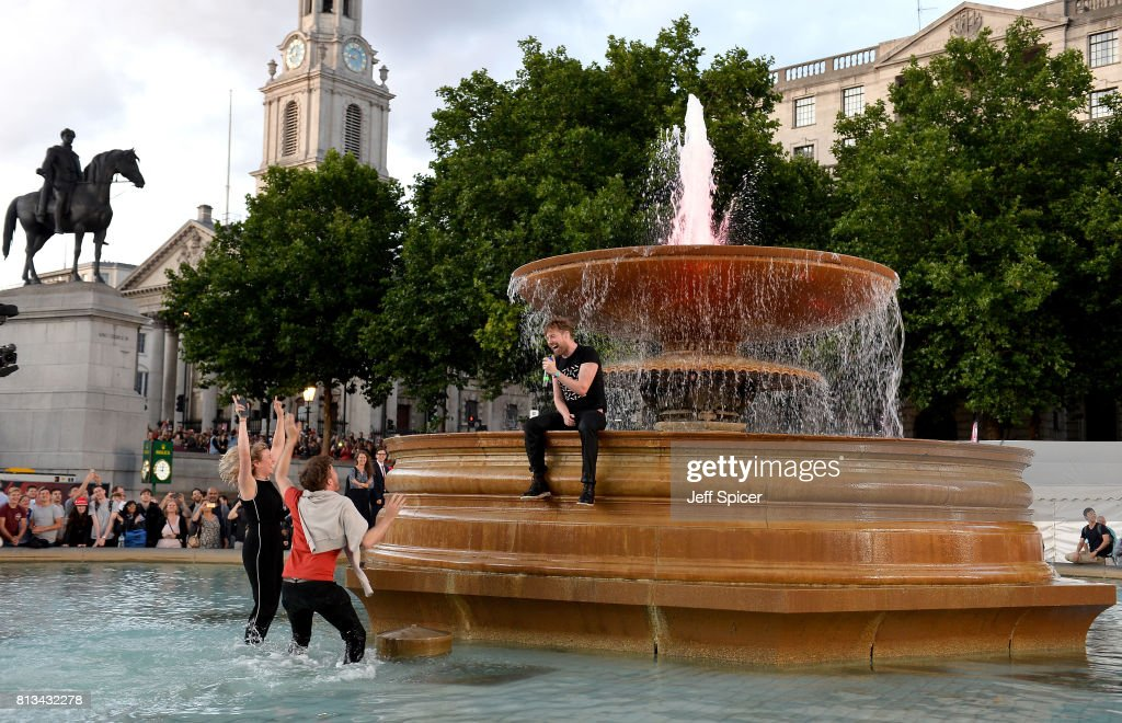 Ricky Wilson of the Kaiser Chiefs performs in the fountain at the F1 Live in London event at Trafalgar Square on July 12, 2017 in London, England. F1 Live London, the first time in Formula 1 history that all 10 teams come together outside of a race weekend to put on a show for the public in the heart of London.